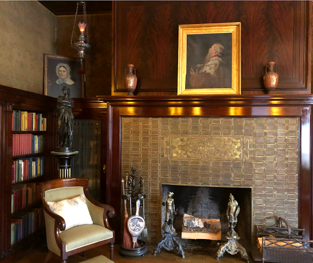 The library with a mosaic fireplace and a painting by Mrs. Congdon above.