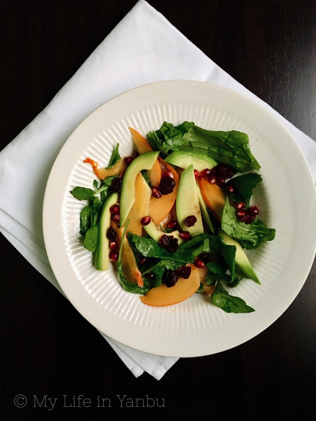Persimmon Avocado Arugula Salad