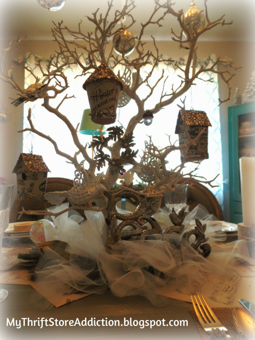 All That Glitters: Rustic Glam Birch Slices and Tablescape mythriftstoreaddiction.blogspot.com Rustic tree branch centerpiece decorated with silver and gold birdhouses and doves