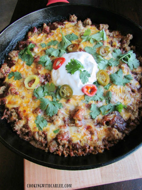 close up of tamale casserole topped with ground turkey, melted cheese and all sorts of goodies