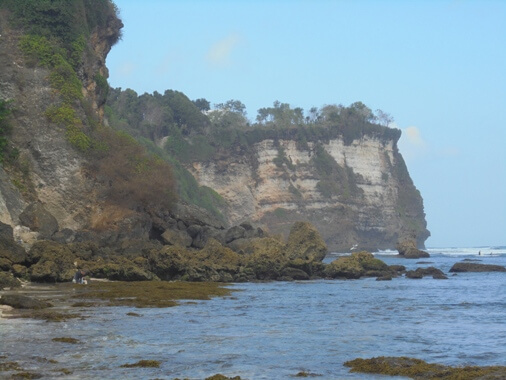 is a hidden beach too famous for its unique entrance through broad cave openings leading t BeachesinBali: Suluban Beach Uluwatu in Pecatu, Bali