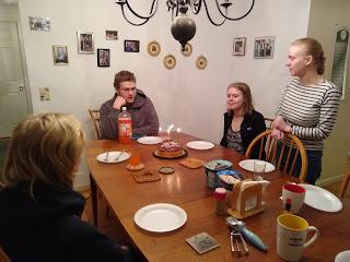 Jane, Erik, Sylvia and Dawn around the table with cake