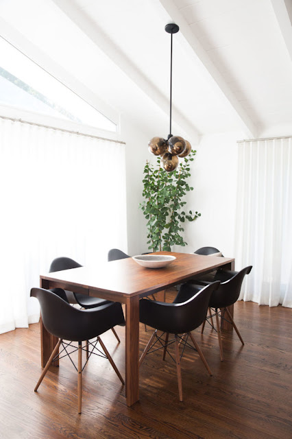 Dining room with wood floor in midcentury modern Brendon Urie house