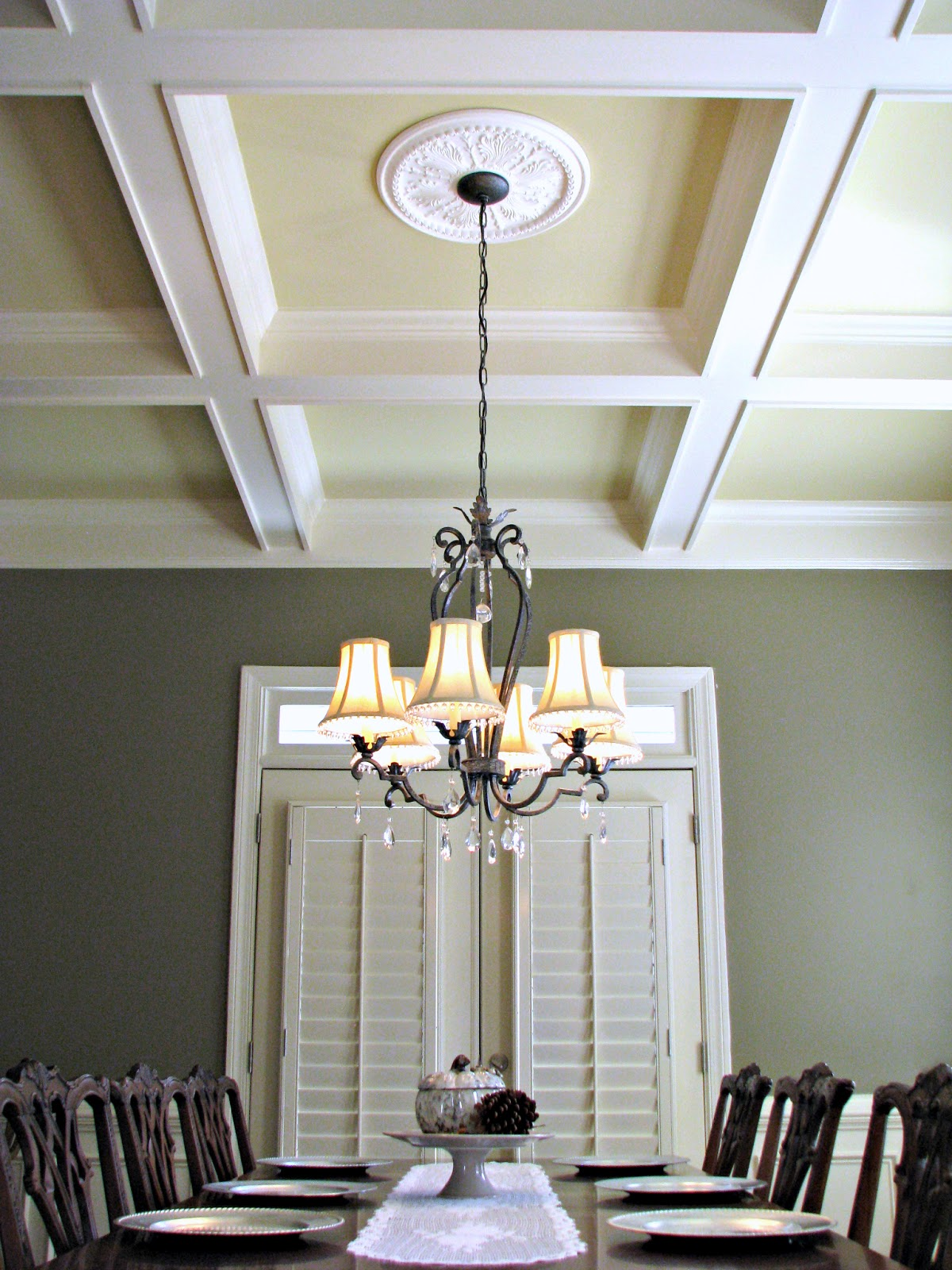 Dining Room With Coffered Ceiling Medallion And Wrought Iron Chandelier