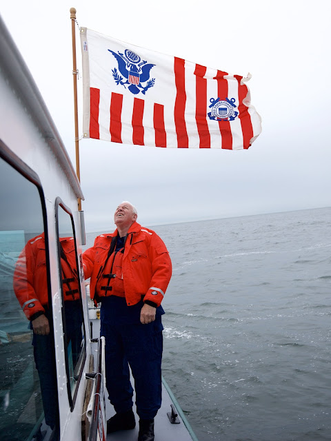 John Fisher checks the Coast Guard ensign