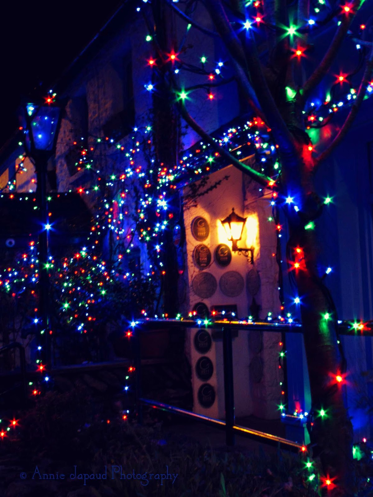 Christmas lights around a door frame