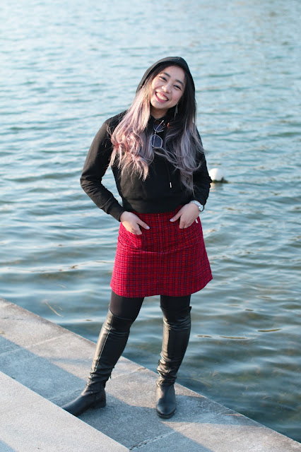 This is a photo about how to wear over knee boots with plaid skirt and sporty top from www.sidneyscarlett.com