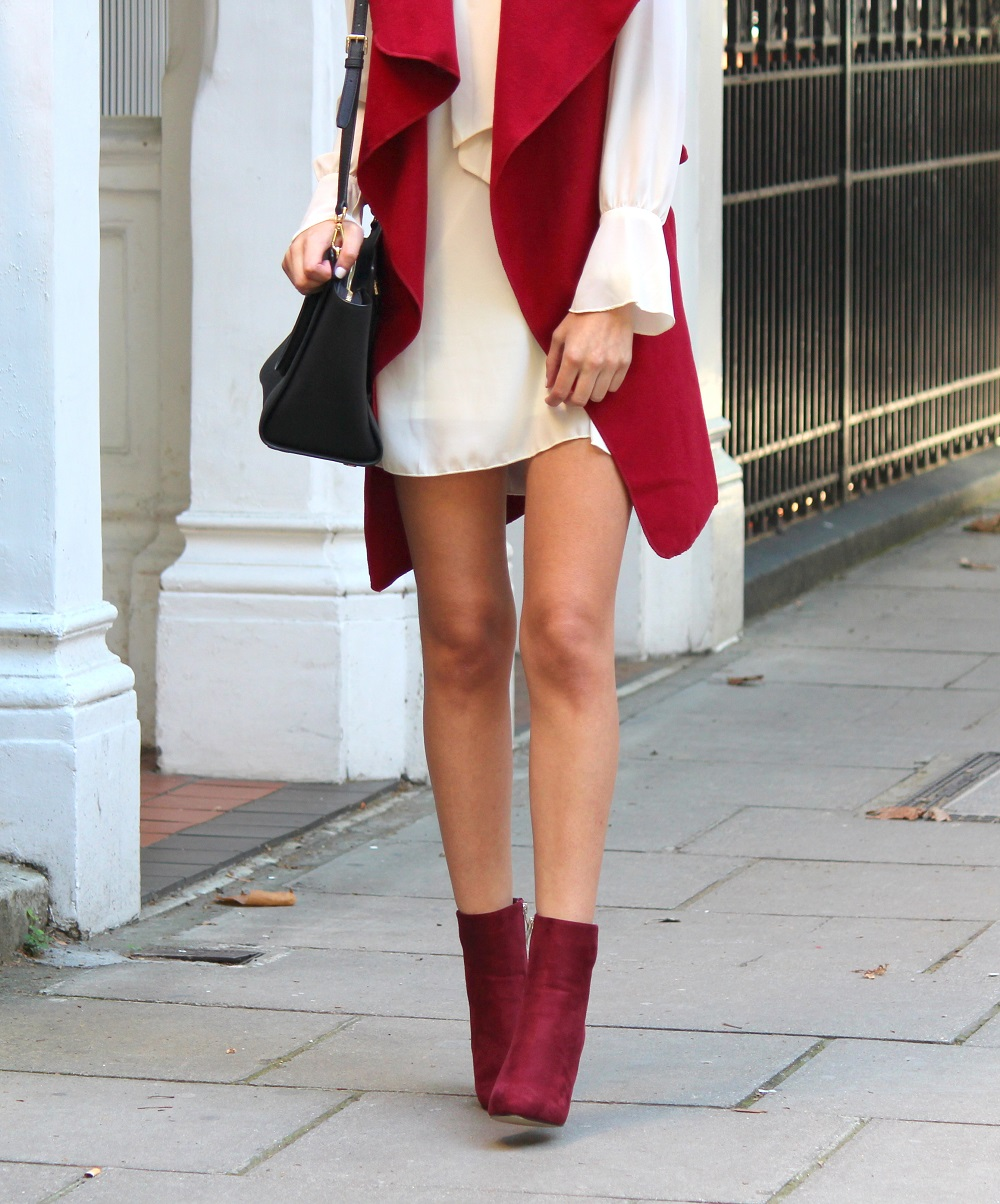 peexo fashion blogger wearing 70s skinny scarf dress and waterfall waistcoat and burgundy suede boots