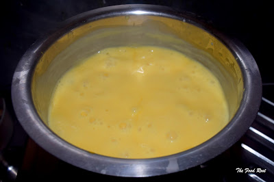 Dry Fruit Custard - Next, add the custard paste in the hot boiling milk. Keep stirring until there are no lumps.