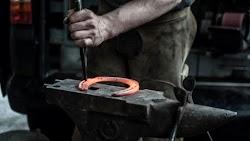 Blacksmith doing a Horseshoe