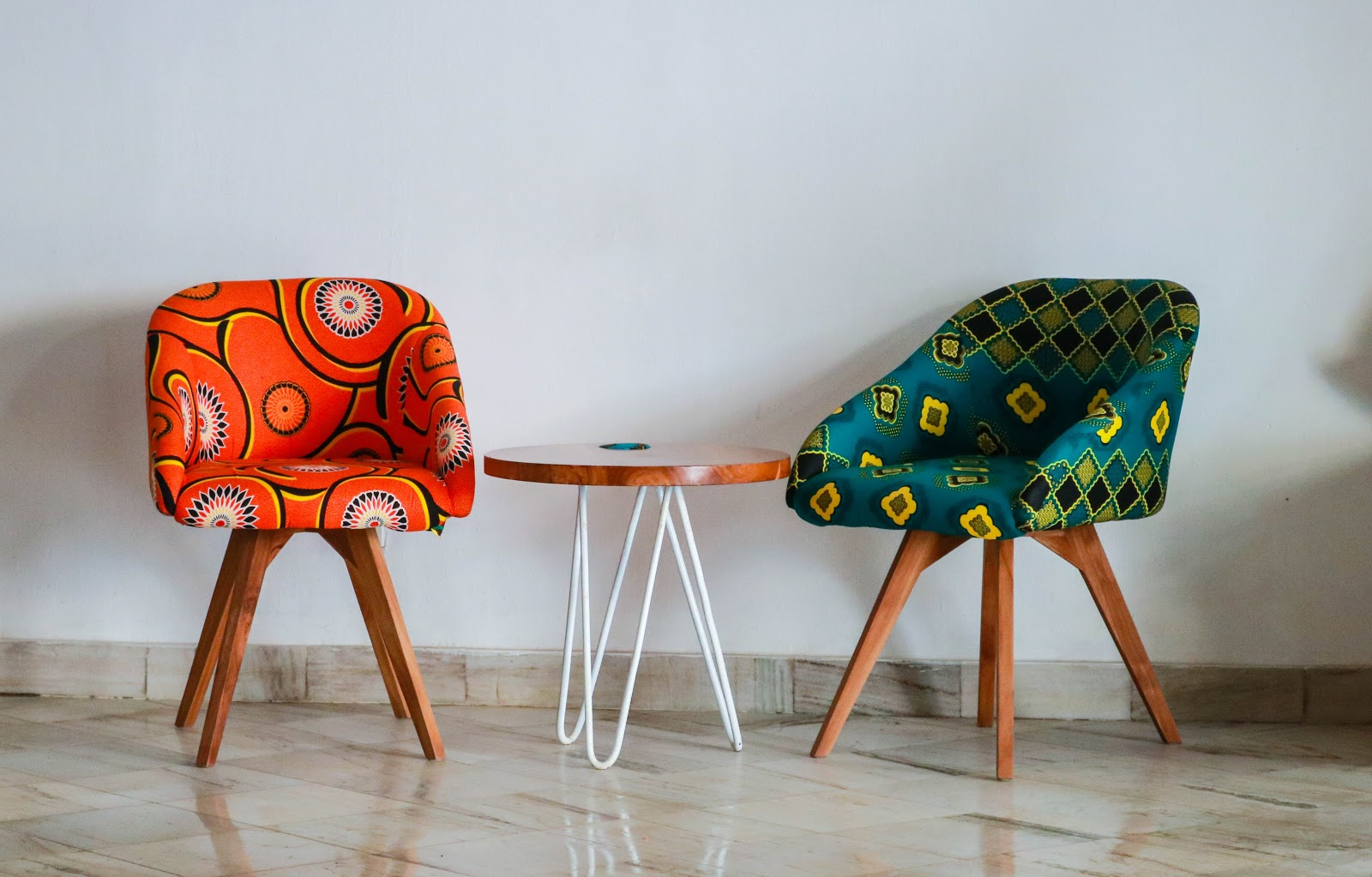 Two Assorted-color Padded Chairs Near Side Table