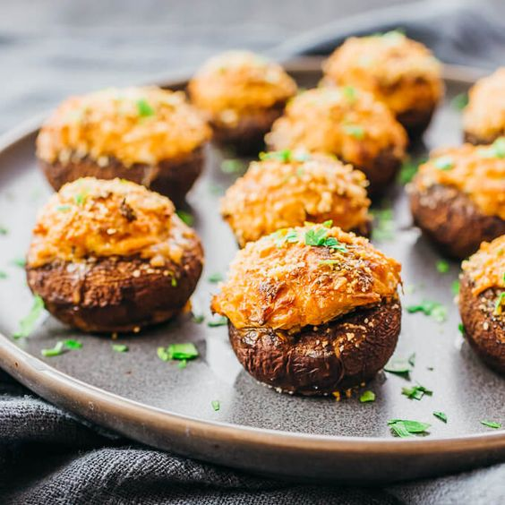 Make this for dinner: the best crab stuffed mushrooms recipe with cream cheese! #lowcarb #keto #healthy #appetizers It's super easy and simple, and reminds me of the ones at Red Lobster, Outback. or Olive Garden. My healthy version skips panko bread crumbs so it's low carb & keto. I use real canned crab lump meat & cream cheese to stuff the mushroom caps. garlic / seafood / baked / families / gluten free / diet