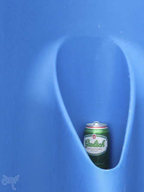 blue urinal with beer can