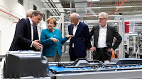 German chancellor Angela Merkel visits Accumotive's plant in Kamenz, Germany. (Credit: Photograph by Robert Michael | Getty) Click to Enlarge.
