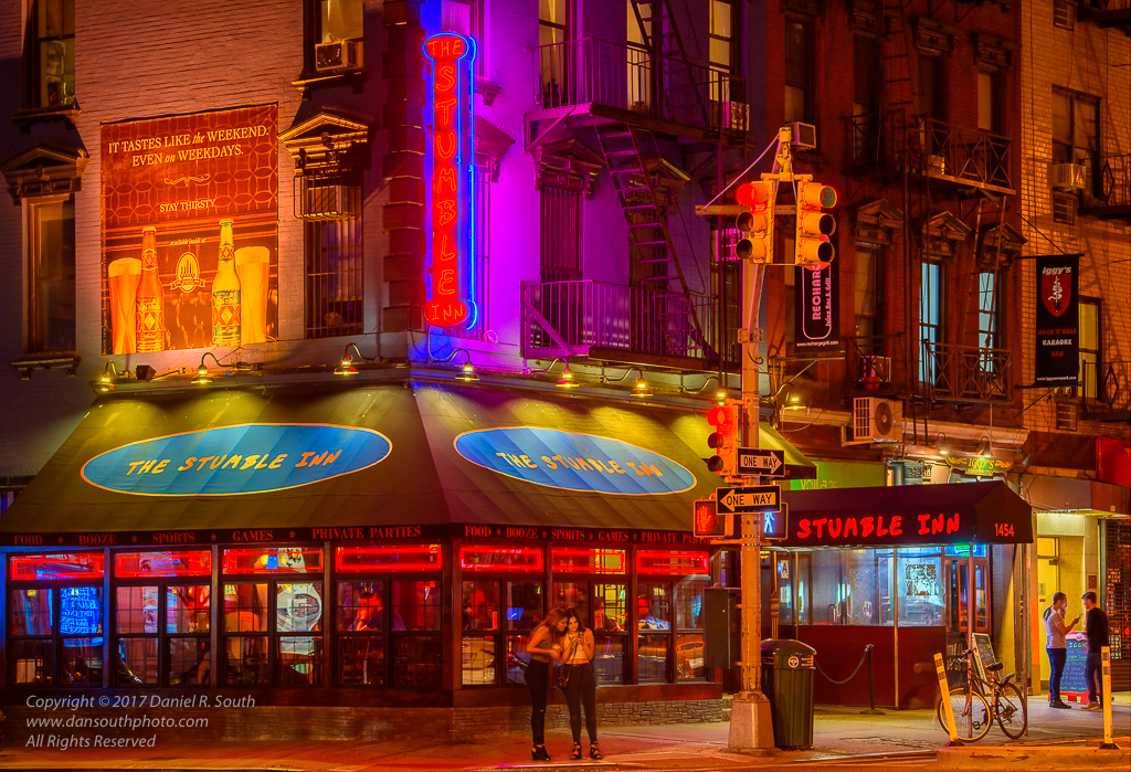 a photo of a colorful new york city bar with neon lights