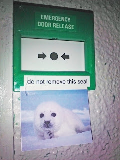 Emergency Door Release do not remove this seal, emergency door funny picture, seal, funny picture seal