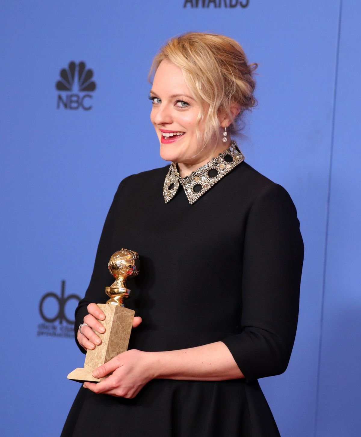 HD Photos of Elisabeth Moss At 75Th Annual Golden Globe Awards In Beverly Hills