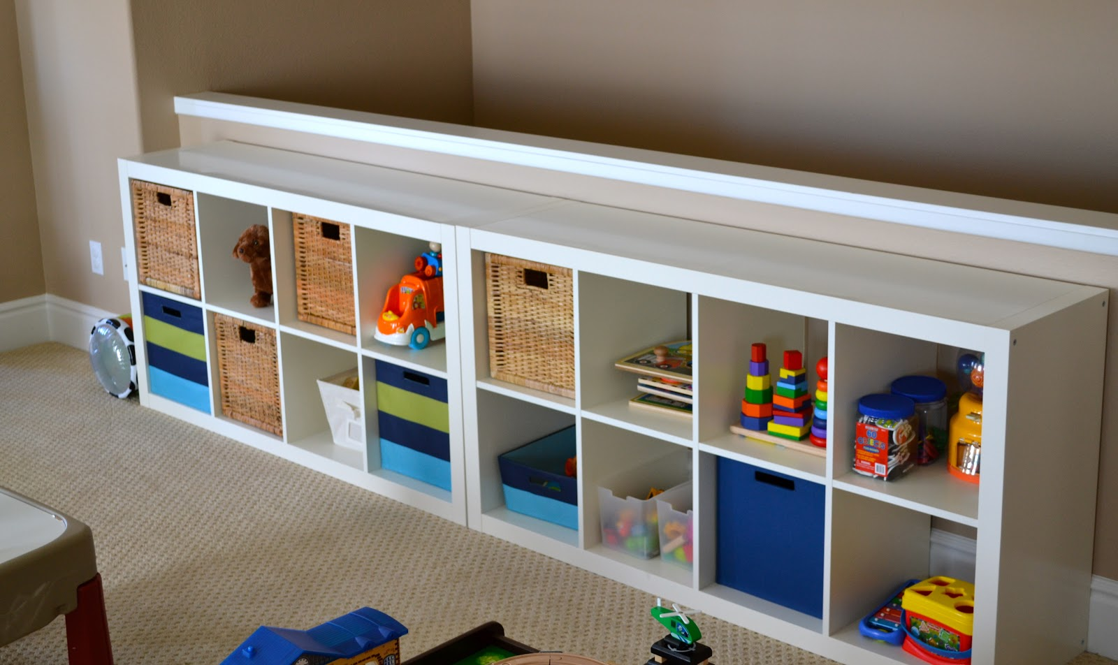 Playroom tour with lots of diy ideas color made happy for Living room toy storage ideas