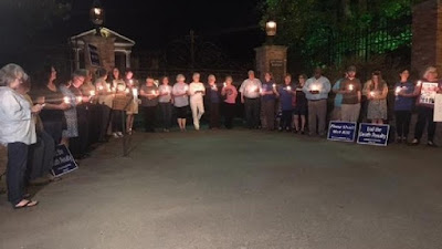 Protesters with Arkansas Coalition to Abolish the Death Penalty gathered outside the governor's mansion