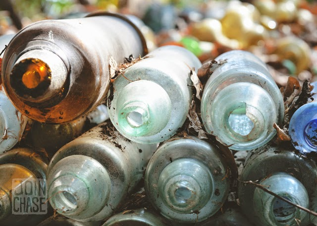 Colorful broken bottles stacked on top of each other around Nagar Glass Factory, Yangon, Myanmar.