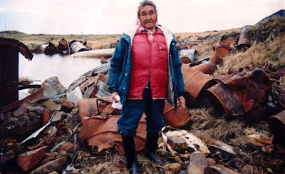 Annie Alowa at a contaminated site on St. Lawrence Island. Alowa led the effort to get the U.S. Army Corps of Engineers to clean up Northeast Cape. She died from liver cancer in 1999.  In 2016 she was inducted into the Alaska Women's Hall of Fame. Photo courtesy Alaska Community Action on Toxics.