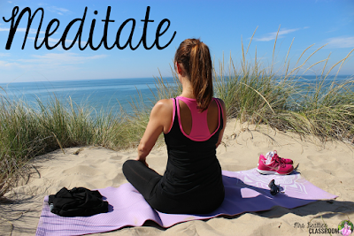 "Photo of woman meditating on beach with text, ""Meditate."""