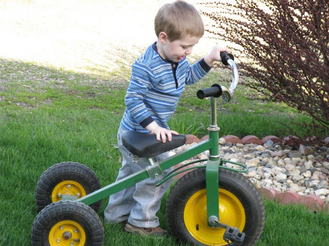 William playing with a tricycle