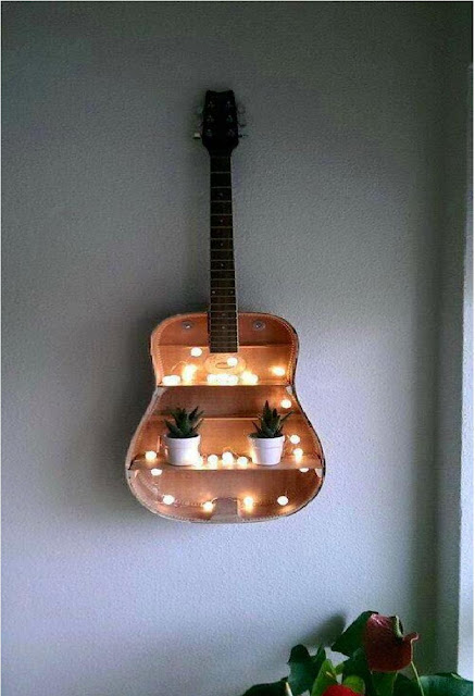 Old guitar you can reuse as a book shelves