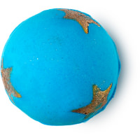 A bright blue spherical bath bomb with bright gold stars on a white background