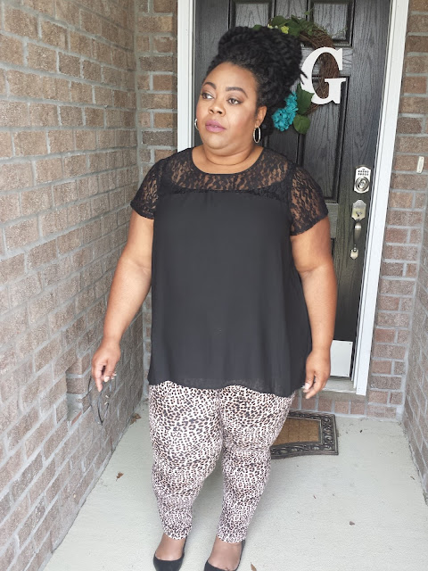 Plus size outfit of leopard print jeggings, black flats and black chiffon blouse