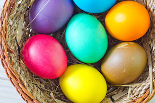 Photo of Easter eggs in a wicker basket