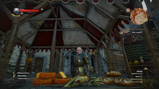 Geralt behind a market stand, trying to sell vegetables.
