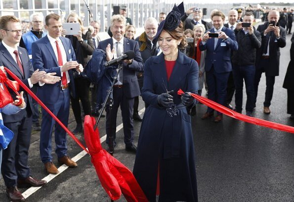 Crown Princess Mary officially opened Crown Princess Mary's Bridge in Roskilde.She is wearing blue coat and dolce Gabbana dress
