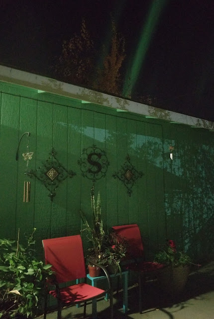 color of the house outside and the Aurora Borealis or Northern light are almost the same