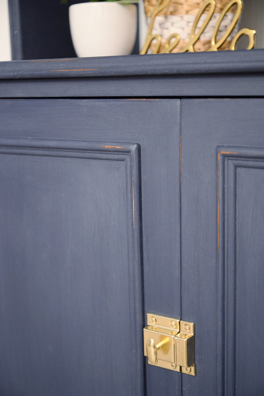 Navy chalk style FAT Paint with brass catch latch | Ramblingrenovators.ca