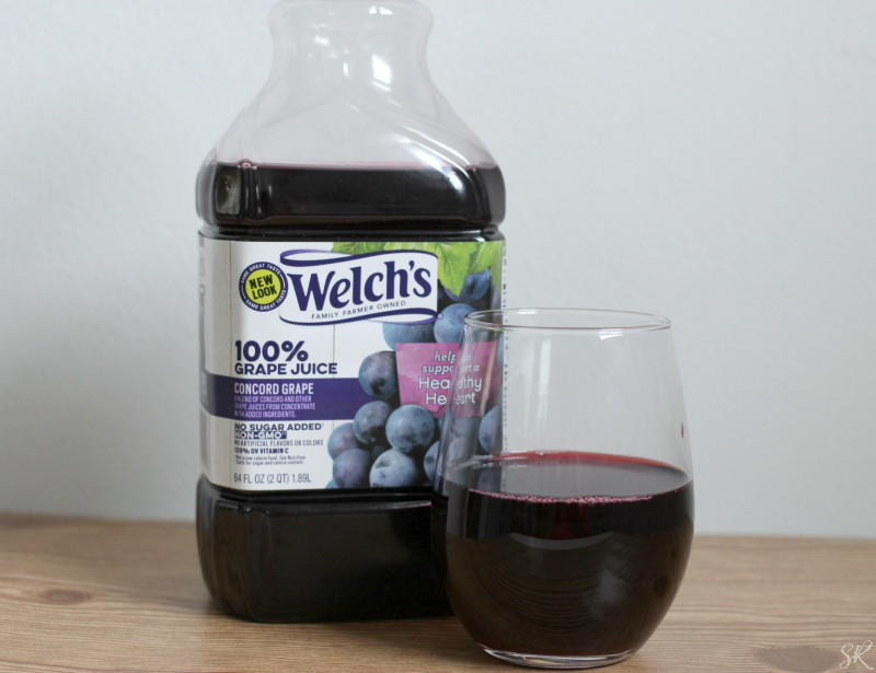a picture of Welch's grape juice and a glass on a counter