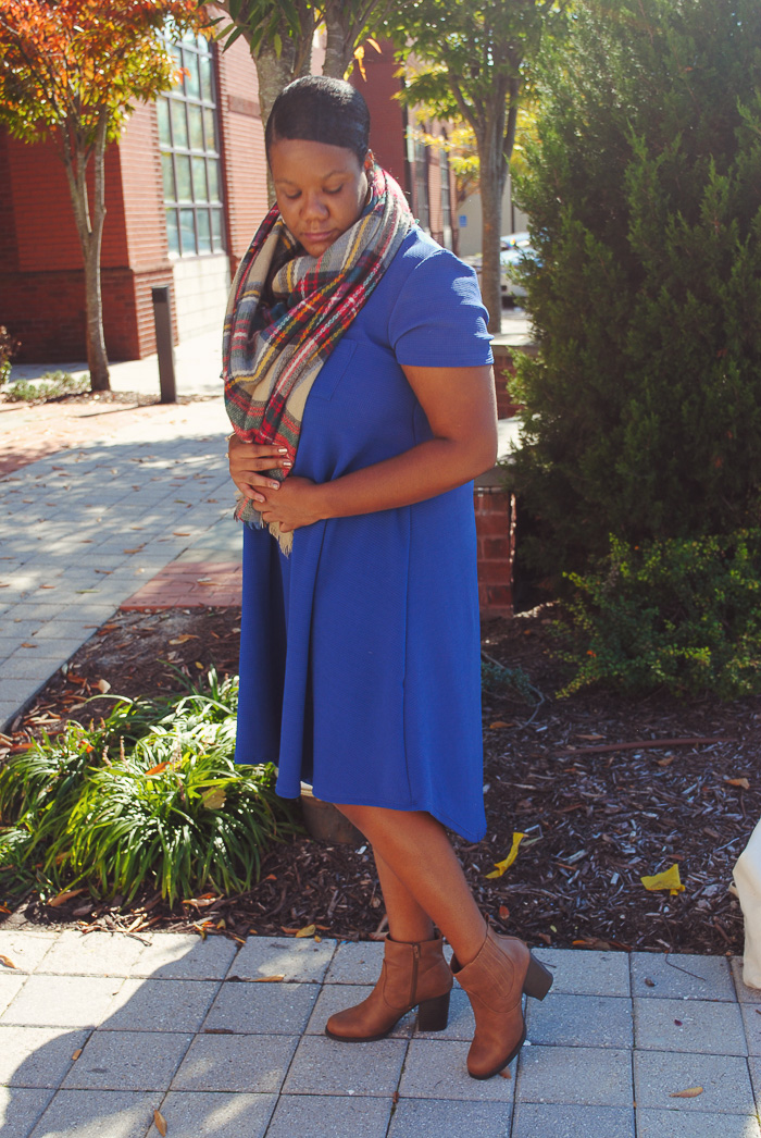 """I was fortunate enough to have a LulaRoe mother/daughter team, Shannon and Meg, send me a couple of pieces to style for you guys. I have to admit I thought LulaRoe only made leggings, but they have so many amazing pieces for all types of women. I've already worn this beautiful 'Carly' dress twice and I'm itching to buy a couple to style in different ways. The Carly is described as """"a cute dress that lets us breathe and move easier - a swing dress that flatters the best parts of a feminine physique while being flowy and breezy everywhere else. The Carly comes in a wide array of fabrics, prints, and washes and has some amazing features such as a patch pocket, a flattering high-low hemline, and cool open sleeves."""" Y'all this dress is simply amazing! It's so soft and comfortable and can easily be layered for chilly fall weather or worn solo on warmer days. Today on the blog I'm sharing how I styled this dress for fall and giving you guys a few tips on how to make this dress work for any fall day!"""