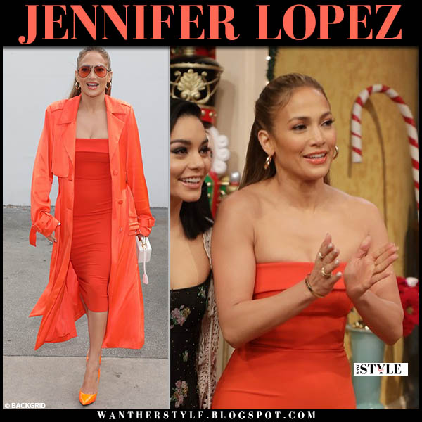Jennifer Lopez in orange trench coat and orange strapless alex perry dress celebrity outfit december 14