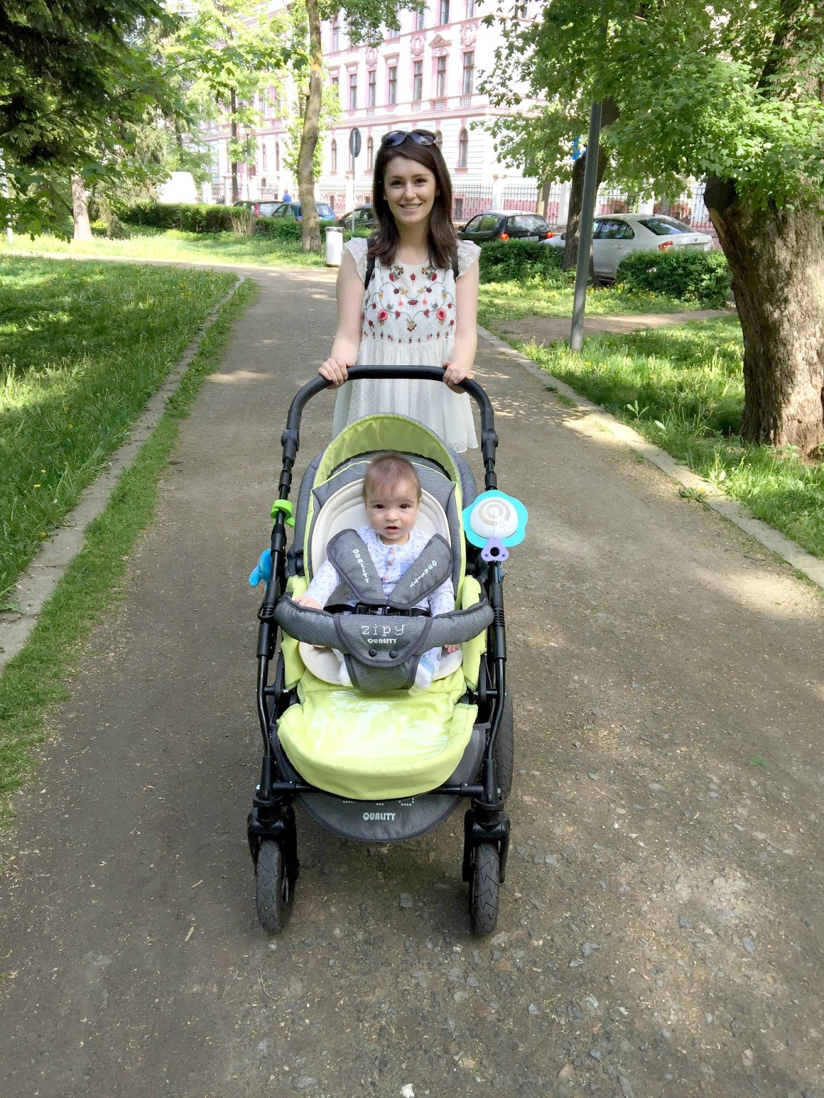 mom wearing embroidered blouse with baby in stroller