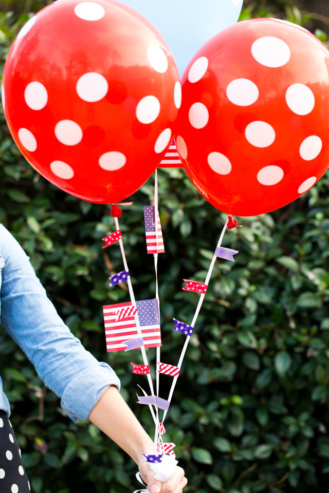 Decorate balloon strings with colorful washi tape for these DIY patriotic balloons!