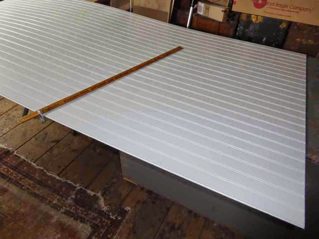 Marking The Trapezoid On The Masonite Panel With A Yard Stick