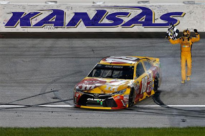 Kyle Busch celebrates after winning the #NASCAR Sprint Cup Series Go Bowling 400 at Kansas Speedway.