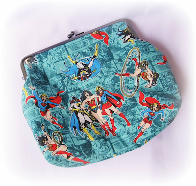 image two cheeky monkeys girl power kisslock frame purse clutch batgirl superwoman supergirl wonder woman camelot fabrics