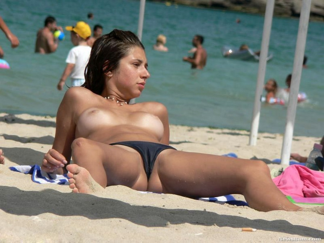 Naked nude candid beach girl touching herself