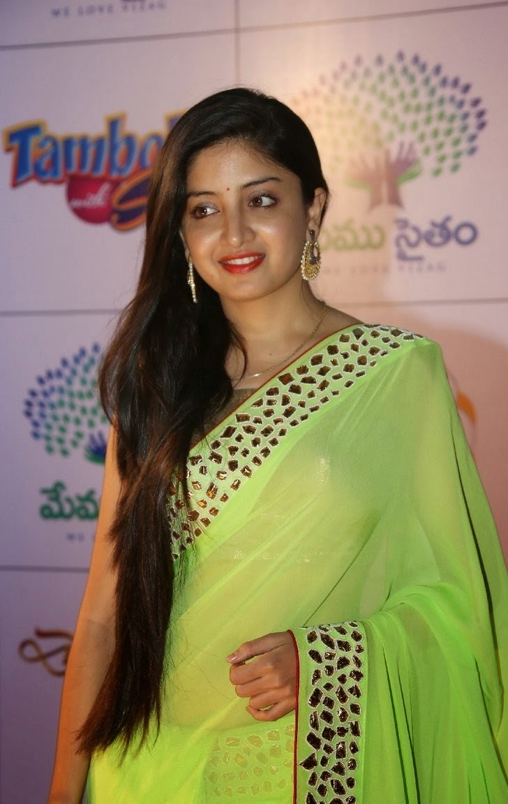 Actress Poonam Kaur Long Hair Stills In Green Saree