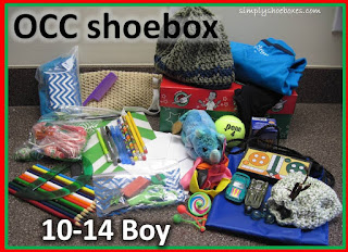 Operation Christmas Child shoebox for 10 to 14 year old boy with clothing.