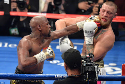 Photos: Floyd Mayweather Jr. defeats Conor McGregor in 10th Round T.K.O
