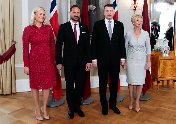 Crown Princess Mette Marit wore Valentino Lace Coat for visit to Latvia. President of Latvia, Raimonds Vējonis and First Lady Iveta Vējone