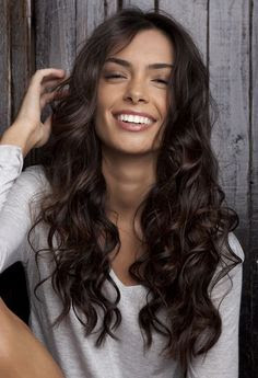 http://favehairstyles.com/2015/11/19/30-cute-styles-featuring-curly-hair-with-bangs/