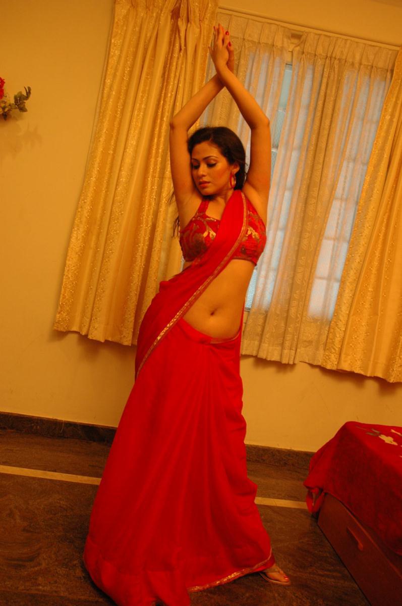 gorgeous and splendid Sada latest hot navel show stills in red saree